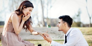 man proposing to girlfiend outdoors